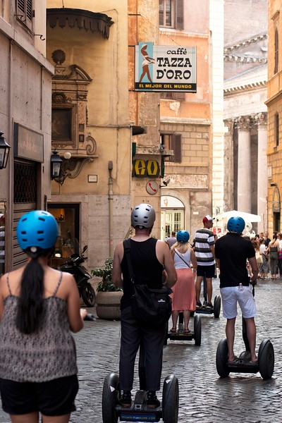 I always take a photo with this perspective--Caffe Tazza D'Oro (absolute best coffee drinks in Rome), with modern citizens  moving towards the ancient Pantheon.
