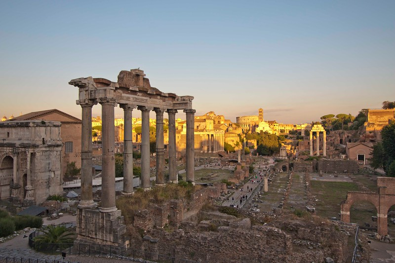 The Forum, where public activity was centered in ancient Rome.  The setting sun's rays lit the Colossum in the background.