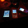 phones on a table: the iphone vs the nokias