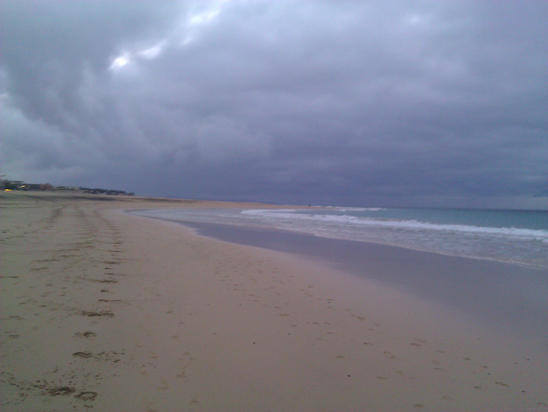 running on playa de jandia at sunset