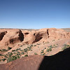 massive rounded cliffs behind Delicate Arch