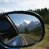 the Grand Tetons fill the rear view mirror