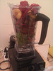 "today's smoothie: swiss chard/mangold ""bright lights"", banana (hidden), apricot, strawberry, lemon juice, water"