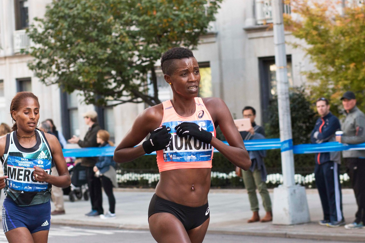 Diane Nukuri, Burundi, 5th Place Women, 2:33;04, followed by Aselefech Mergia,  Ethiopia, 6th Place, 2:33:28