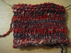 scalleywag bfl swatch in the round, handspun on a drop spindle, between lace and fingering weight after plying as a 2-ply