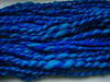 teal and blue (camera didn't like the teal, it looks light blue here) handspun on a spindle