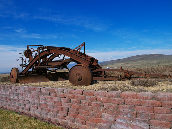 Old steel wheeled road grader.
