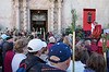 12 April 2018: the square outside the Santa Faz monastery. People are waiting for the relic to be brought out and for Mass to be said by the archbishop of Alicante. The priest is giving people an update on the preparations inside the church.