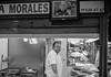 25 October 2016: the friendly butcher at Mercado Central. Leica M2, 50mm Summilux, Fuji Acros.