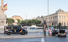 21 July 2016: Madrid police stop to help a motorist change the wheel on Plaza de Colón.