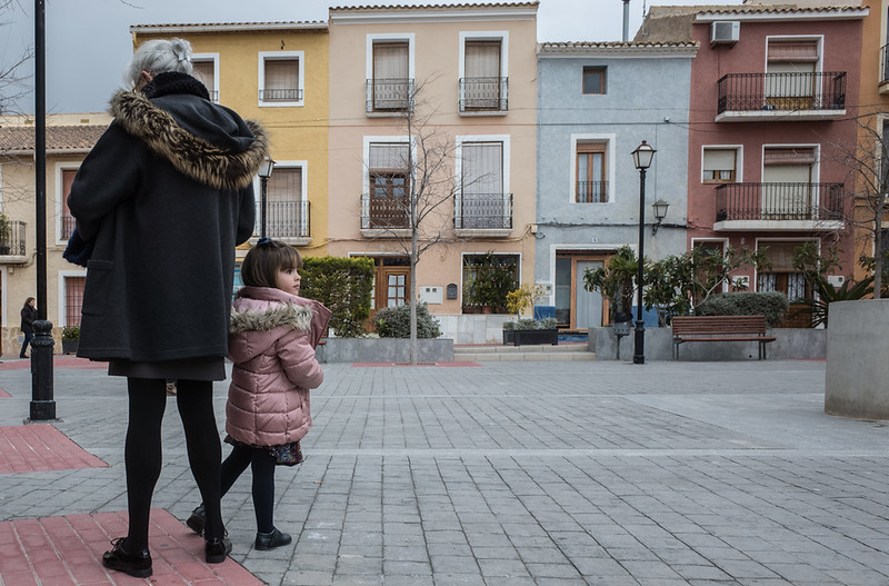18 February 2018: the square in Aigües. Two females of different ages, both dressed in their Sunday best.