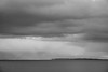 28 April 2016: grey heavy clouds over Øresund, as seen from Humlebæk north of Copenhagen. The land in the distance is Sweden.