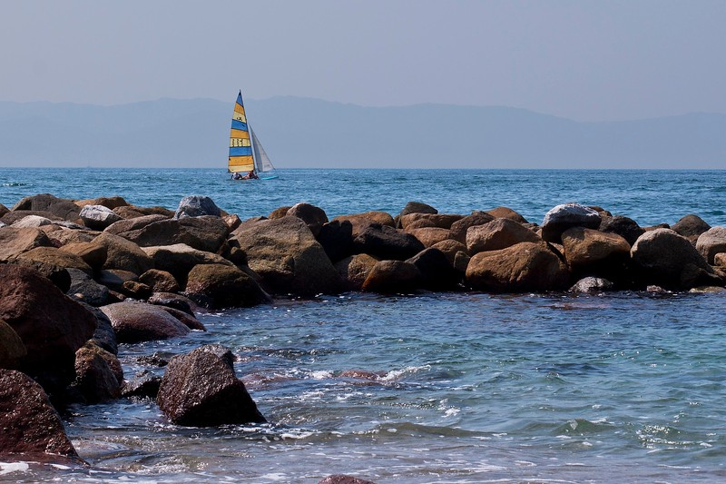Jetty, Sailboat and Mountain