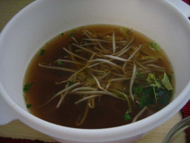 step 5: ladle the broth over the plated up ingredients