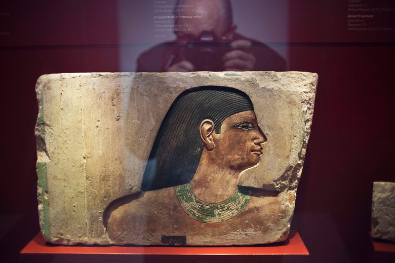 Photographer Taking Photo of Egyptian Relief Fragment, IVth Dynasty (2500 b.c.), Vatican Museum