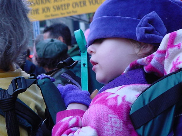 peering out at the parade