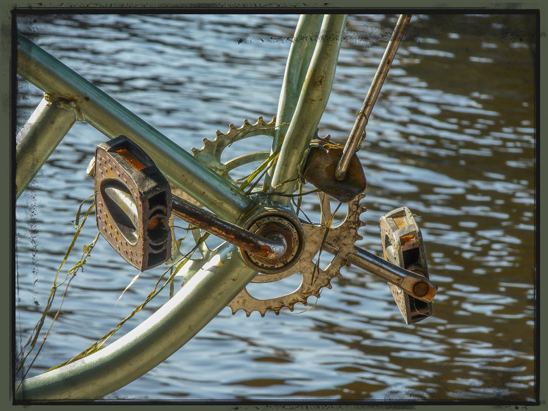 Chainwheel, crank, pedals and frame. Even a kickstand. But, you can be sure that this relic under the bridge won't win any races.