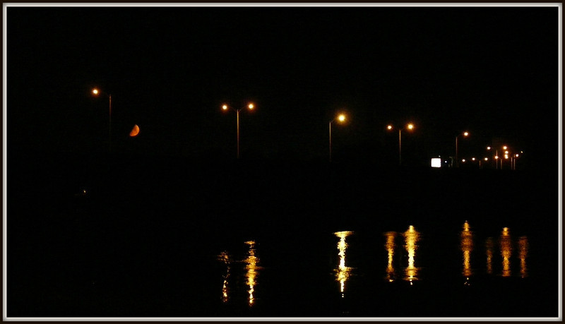 I raced to the end of 1st Blvd to catch the moon.  Of course, I caught the lights and their reflections too.
