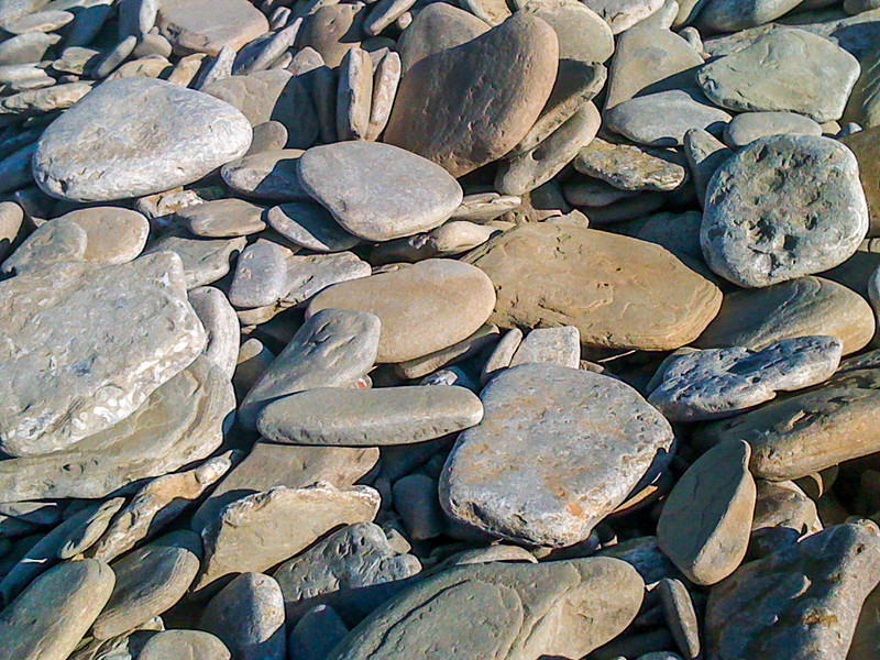 Flat stones on the Big Bay beach in Ontario.