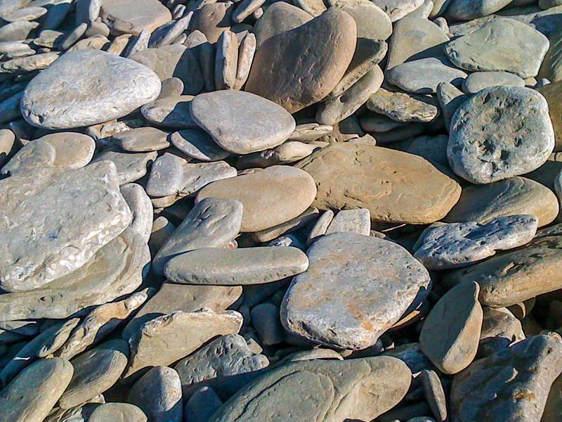 Flat stones on the Big Bay beach in Ontario.