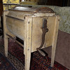 An antique butter churn in our River House Lodge at Phineas Swann.
