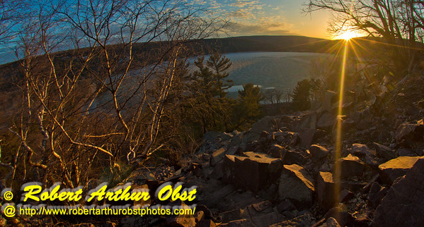 Hiker's view from the Balanced Rock Trail of the last Golden Rays of a spring sunset over ice covered Devils Lake within Devils Lake State Park (USA WI Baraboo; Obst FAV Photos 2013 Nikon D800 Daily Best Obst Image 8887)
