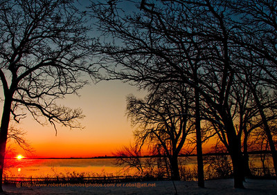 Hiker's view of crimson sunrise over Lake Mendota towards the Madison Wisconsin capitol from Governor Nelson State Park (USA WI Waunakee)