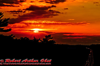 Crimson Sunset over Central Wisconsin Highway 21 after rainfall near Coloma (USA WI Coloma)