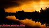 Dazzling Crimson Autumn Sunset through Fog and Storm over Wisconsin River near Tomahawk (USA WI Tomahawk)