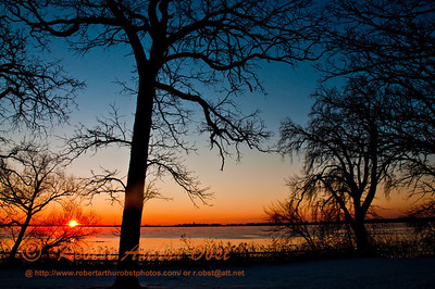 Crimson sunrise over Lake Mendota and the WI State Capitol from Governor Nelson State Park Borchers Beach Road (USA WI Waunakee)