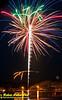 Boaters enjoying spectacular fireworks over White Lake during the fourth of July celebration (USA WI White Lake)