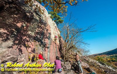 """""""Rock climber's and hiker's view from the Balanced Rock and Ice Age Trails of climber on Devil's Lake State Park's east bluff during autumn - Images from FAV or Favorite Obst Family OUTINGS within sixty miles or 60 MI or about an hour drive of the Madison and Middleton areas within southern Wisconsin USA"""" (USA WI Baraboo; Obst FAV Photos Nikon D800 Daily Best Obst Image 4420)"""