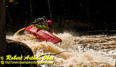 Open canoeist solo woman or OCW1 precariously counter leaning and fighting to try and stay upright in a curler hole within Gilmores Mistake Rapids at 1400 frigid CFS or 25 inches on Section 3 of the wild Wolf River within Langlade County (USA WI White Lake; Obst FAV Photos 2013 Nikon D300s Daily Best Obst Image 5264)