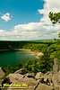 Hiker's view of blue skies over turquoise Devils Lake and quartzite boulders along East Bluff Trail within Devils Lake State Park (USA WI Baraboo)