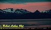 Rosy early morning sunrise over Grewingk Glacier and the Kenai Mountains within Kachemak Bay State Park on the Kenai Peninsula (USA Alaska Homer)