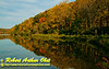Blue skies and resplendent autumn colors encircle fisherman on Indian Lake within Indian Lake County Park (USA WI Cross Plains; RAO 2012 Nikon D300s Image 3575)
