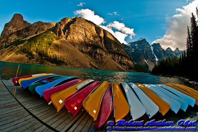 Cerulean skies over canoes, mountains and turquoise Moraine Lake within Banff National Park (Canada AB Lake Louise)