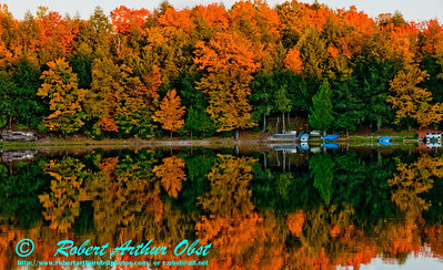 Canoeist's view of autumn magic reflections at sunset over Mueller Lake within northeastern Wisconsin near Polar (USA WI Polar)