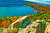 East Bluff Trail Hikers' enjoy blue skies over granitic rocks, gorgeous autumn foliage and blue waters within Devils Lake State Park (USA WI Baraboo)