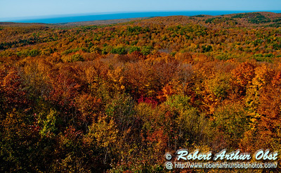 Hiker's enjoy views of blazing autumn foliage from the Summit Peak Scenic Area Observation Tower within Porcupine Mountains Wilderness State Park (USA MI Ontonagon)