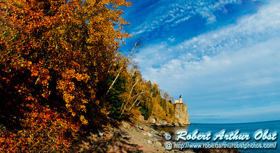 Blazing autumn foliage and bright blue skies frame cliff top Split Rock Lighthouse Minnesota State Historic Site on Lake Superior (USA MN Two Harbors; RAO 2012 Nikon D800 Image 6396)