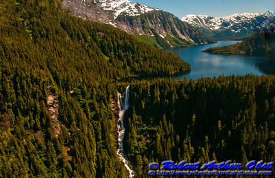 Granite mountains encircle hanging valley lake drained by a waterfall within the rugged Misty Fiords National Monument (USA Alaska Ketchikan)