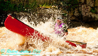 Turbulence engulfs whitewater solo canoeist Charles Frisk within Ducknest or Lower Sullivan Rapids at a river flow of 744 CFS on the wild Wolf River Section 4 within Menominee Indian Nation  (USA WI Keshena)