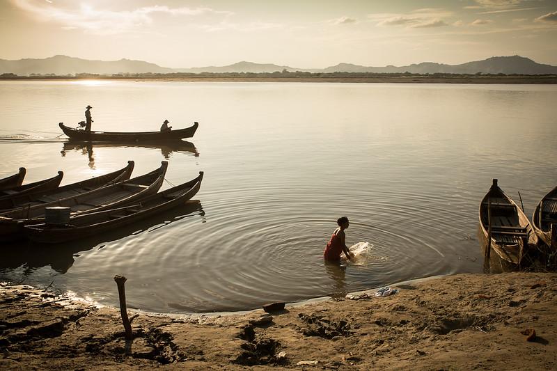 Woman taking a bath in the Irrawaddy river in Bagan