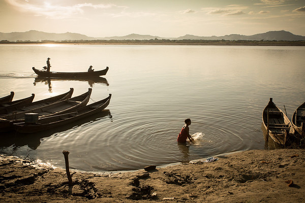 Woman taking a bath in the Irrawaddy river in Bagan
