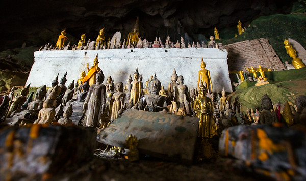 Cave with hundres of Buddhas by the Mekong river