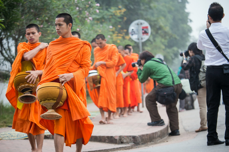 Disrespectful photographers in Luang Prabang