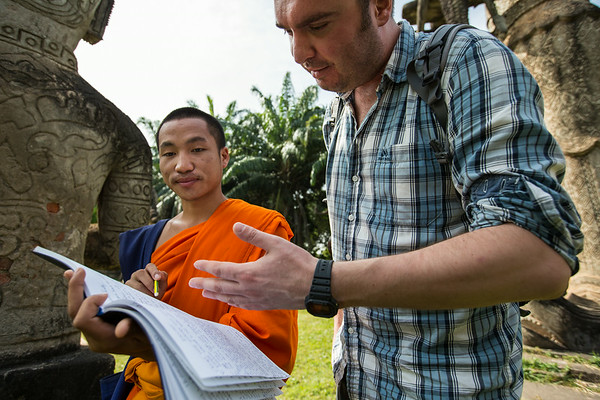 Helping monk with english homework in Vientiane