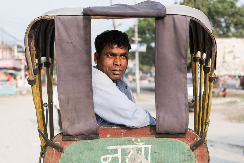 Rickshaw driver waiting for customers in Damak