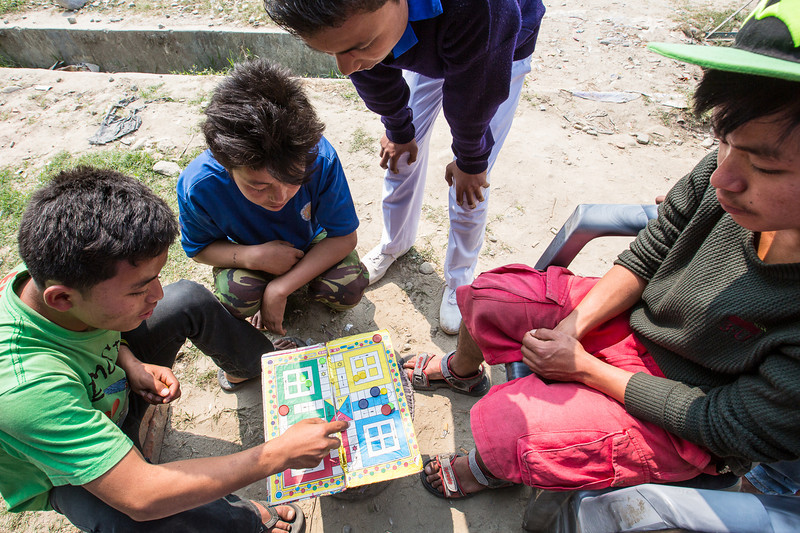 Boys playing Ludo in the streets of Damak